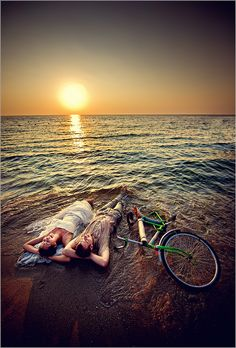 sunset ocean bicycle engagement or couples picture. Gorgeous!