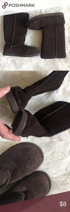 Girls genuine suede boots Worn a few times but there is some wear on the heel and toes. Priced accordingly. Genuine suede leather. Cozy faux fur interior. Similar in style to popular uggs boots. Add this to a bundle to save 15%. Circo Shoes Boots