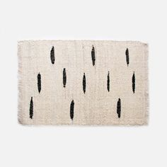 Flat woven rug made from fique, a fiber from a plant (similar to agave sisal) that is commonly grown in South America. Finished with a fringe trim along the top and bottom. Handwoven by artisans from