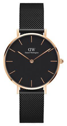 Daniel Wellington Horloge Classic Petite Ashfield 32 mm DW00100201. Elegant en trendy vormgegeven horloge met een ultradunne kast van 6 mm. De rosékleuriuge, stalen kast heeft een doorsnee van 32 mm en is voorzien van een zwarte wijzerplaat voorzien van rosékleurige index en wijzers. Dit model heeft een zwarte Milanese (mesh) horlogeband voorzien van een klepsluiting.