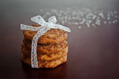 https://www.facebook.com/visualsoulphotography shiny cookies tied in lace in a minimal composition with sugar bokeh in the bg