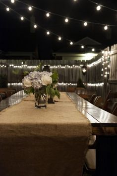 string lights, burlap table runner.