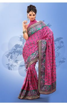 We Have Ensemble A Symphony Of Enchanting Piece To Restyle Your Senses. Women Beauty Is Magnified Tenfold In This Alluring Deep Pink Art Silk Saree. The Lovely Lace, Multi, Resham & Stones Work A Substantial Feature Of This Attire.