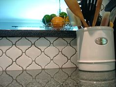 pretty geometric tile, beautiful grey granite countertops (the pretty sparkly ones from lowes) links to a similar tile at overstock.com