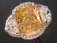 Yellow Diamond Ring ITEM #: R4072  CENTER STONE: WEIGHT: 3.25ct SHAPE: Cushion Cut COLOR: Fancy Light Yellow CLARITY: VS1 MEASUREMENTS: 9.40 x 8.16 x 4.96 mm TOTAL DEPTH: 60.8% TABLE SIZE: 58% POLISH: G SYMMETRY: G FLUORESCENCE: NONE GIA REPORT #: 14341519  SIDE STONES: TOTAL WEIGHT: 0.75cts QUANTITY: 2 SHAPE: Half Moon (Step Cut) COLOR: F CLARITY: VS  MOUNTING: Platinum and 18Karat Yellow Gold