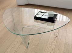 Contemporary Unico Snodo Glass Curved Coffee Table http://www.furnituremind.co.uk/product.php/3662/12/contemporary-unico-snodo-glass-curved-coffee-table