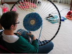 Weaving on a hula hoop.  Love this idea!