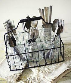 cutlery in mason jars in a basket
