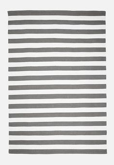 A striped rug never goes out of style, whether you're accenting the hallway of your beach house, or adding a cosy touch to your bedroom. Inspired by the craftsmanship of traditional Indian rugs, this cotton dhurrie design has a thick, flat weave that provides warmth during winter whilst keeping cool in summer.