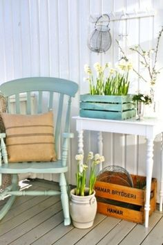 Wooden crate to corral fishing tackle, modify table to store rods. Like the pastel turquoise chair.