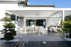 How pergola would look in backyard. White horizontal beam.