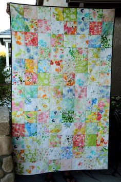 A throw sized quilt, made entirely of vintage linens in a variety of floral prints.  Absolutely love these colors.. combines my love of linens and quilts.