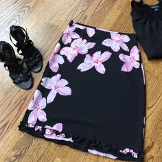 """Just in The Limited floral skirt The Limited skirt. Black with pink flowers. Size 4. Side zipper. Pretty ruffle detail around hem. Waist flat is 14"""", length 22 1/2"""". Material is 100% polyester. Machine washable. The Limited Skirts"""