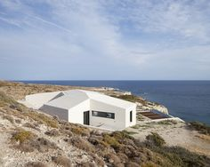 The overall design strategy was to segregate the rural areas of the landscape from the wild ones with clearly defined borders that form four distinct corrals. The home is organized around exterior courtyards which are used to funnel and control the prevailing winds and provide passive ventilation. #home #sea #greece #grecia #islascicladas #caliza #acantilado #cliff #architecture #arquitectura #selectahome #escalera #vivienda #piedra #stone