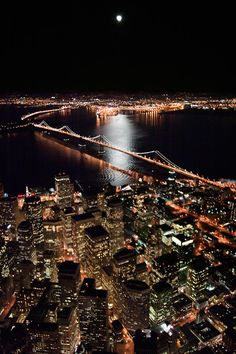 The Bay Bridge and the SF Bay Illuminated at night, San Francisco, California.Love the Bay Bridge. Pacific Coast Highway, San Francisco At Night, San Francisco California, California Usa, San Francisco Skyline, Places To Travel, Places To See, Magic Places, Beau Site