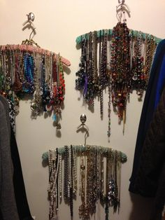 Necklace organizers: Grandmothers crocheted covered, wooden hangers strategically nailed to the wall of my closet, makes perfect necklace organizers by color and seasons; spring/summer, autumn/winter and year round. The crocheted pattern enables the necklaces to hang without falling off.