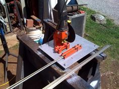 Cut-Off Saw by aametalmaster -- Homemade cut-off saw constructed from bar stock, steel plate, and an angle grinder. http://www.homemadetools.net/homemade-cut-off-saw