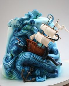 Great Birthday Cake Ideas for Boys - This cake looks weird at the beginning but if you take a closer look you will appreciate the genius of it. The boat, the sails, clouds, anchor, kraken hands are all part of the story. All parts of the cake are edible (almost:)).
