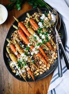 This roasted carrot dish would look great on your holiday table! It's also a well-balanced weeknight dinner. cookieandkate.com