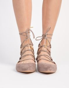 Your feet will thank you for these taupe Pointy Lace-Up Flats! Made from a faux suede material. Features a pointy toe construction, lightly padded insole, adjustable lace-up design, and an exposed bac