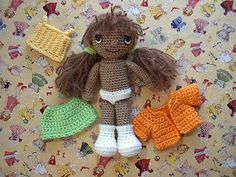 Click on this link: this woman makes the cutest dolls and clothes and has patterns for FREE!!! doll with clothes free crochet pattern by blogger By Hook, By Hand