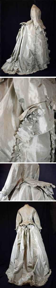 Day dress, ca. 1874, of silk taffeta in a steel gray and black stripe. It consists of a basque bodice embellished with ruffles and lined in cotton and also a skirt embellished with ruffles. Internal ribbons can adjust the volume of the bustle. Au Temps Jadis