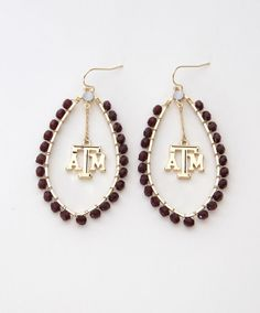 Every outfit needs a finishing touch, and this gold and maroon pair of earrings is the perfect fit! These earrings are featured with the ATM block in the center and maroon beading around the rim. Stone Earrings, Drop Earrings, Aggie Football, Texas A&m, University, Sparkle, College, Gift Ideas, Future