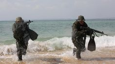 KIN BLUE, Okinawa, Japan – Japanese Ground Self-Defense Force scout swimmers emerge out of the ocean and run to the beach during the Japanese Observer Exchange Program.  Photo: Cpl. Ryan C. Mains/ U.S. Marine Corps