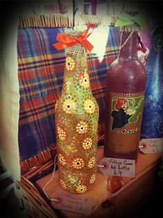 Recycled bottles - for use as candleholders or vases by Ginger Rosie Crafts
