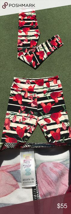 LuLaRoe OS Leggings Tulips with stripes. Major  LuLaRoe Leggings OS RED TULIPS with Black and Cream STRIPES.  Hard to find and highly sought after print.  These are absolutely gorgeous! Super soft and very stretchy.  They are new, do not come with a tag (LuLaRoe does NOT attach them). Smoke free home.  Is this your Unicorn, Arrow, Elephant, Disney Roses, Paisley, Tiger, Dinosaur or Owl Print? I provide same or next day shipping, depending on time of purchase. LuLaRoe Pants Leggings