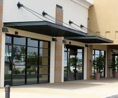 Image result for commercial building with awnings