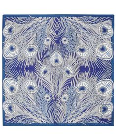 Blue Hera. Credited to Arthur Silver, the founder of the silver studio, in 1887. First printed by Liberty in the mid 1890s, Hera has been in the Liberty range ever since. The peacock feather was a much used symbol during the Aesthetic Movement of the 1880s.