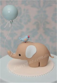 this is adorable. i'm putting it under my food category since it's a fondant cake topper.