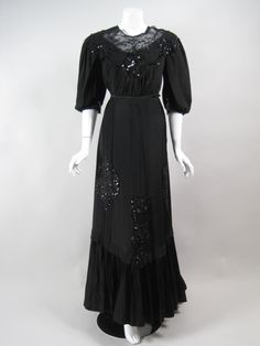 Late 1800's through early 1900's two-piece evening gown is made out of black silk with elegant sequined and beaded lace appliques. Description from extantgowns.blogspot.com. I searched for this on bing.com/images