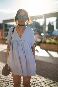 Deep v-neck high waist swing dress with a black faux leather or ribbon choker & round sunnies -- looks like Alexa Chung to me