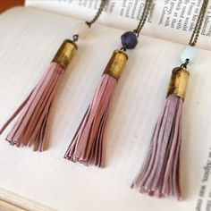 Tassels are IN. Go green by sporting this necklace made of recycled Leather & repurposed bullet shells!
