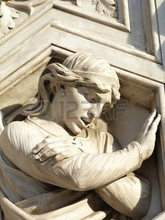 Irreverent angel on the facade of the cathedral of Florence, Italy