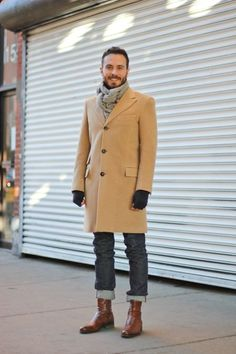 Shop this look on Lookastic: http://lookastic.com/men/looks/scarf-overcoat-gloves-jeans-boots/4703 — Grey Scarf — Camel Overcoat — Black Wool Gloves — Charcoal Jeans — Brown Leather Boots
