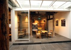 CHONG DE LI Restaurant CH37 dining chairs in oak, oil finish, natural paper cord.