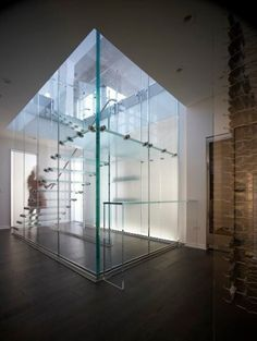 This staircase in a Chicago high-rise duplex is 99 percent glass: glass walls, glass treads, glass guardrails. Only the hand rail and steel connections are a different material. The choice of a glass staircase means light can filter from one floor to the other.