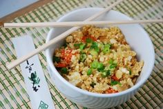CAULIFLOWER FRIED RICE: 1 medium head of cauliflower, grated 1/2 cup frozen peas 1/2 cup carrots, thinly sliced 1/2 of a medium onion, diced 4 garlic cloves, minced...
