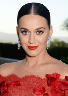 """Round eyes tend to have large defined lids—think Katy Perry, Audrey Hepburn, Nicole Richie and Christina Ricci. """"For large, round eyes I love to use a khol or Kajal pencil inside the waterline to create drama and mystery,"""" says celebrity makeup artist Matin. This will produce a lengthening effect that appears cat-like. Essentially, you'll use the softness of the creamy eyeliner to move it into becoming an eyeshadow. Try Make Up Forever's Kohl Pencil $18. For added drama, draw a thick line…"""
