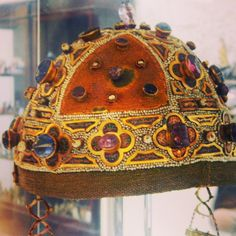 Crown worn by Constance of Aragon (1179-1222) is housed in the treasury at Palermo's cathedral. It is a fascinating example of uniquely Sicilian jewelry-design, exploiting Byzantine, Norman, and Arab influences. It is donned with precious stones like sapphires and rubies, in addition to pearls, gold, and other intricate detailing.