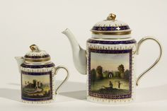 A Russian Imperial Porcelain Teapot and milk Jug decorated in the Neo Classical style with cobalt blue borders. c l762-l796