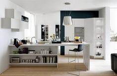 open kitchen in white with wooden flooring