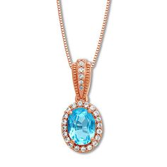 An oval blue topaz encircled by sparkling white topaz is the colorful focal point of this lovely necklace for her. More white topaz line the bail, and the pendant suspends from an box chain that secures with a lobster clasp. White Topaz, White Gold, Gemstone Jewelry, Diamond Jewelry, Diamond Guide, Blue Topaz Necklace, Gold Stock, Cultured Pearls, Jewelry Stores