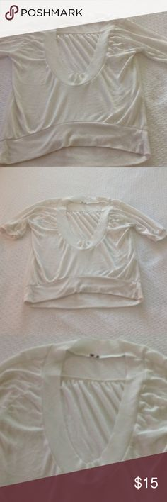 Simply Blouse with cute neck line This is a nice simple cream-colored blouse with a pretty neck line you can wear a camisole underneath or tank top it hangs lower in the back then in the front and it has beautiful sleeves it is in good fair condition. Poof! Tops Blouses