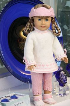 Beautiful doll clothes for American Girl Doll that are knitted.