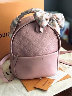Louis Vuitton Backpack with a bandeau! Owner: Christian Cabello (group member)