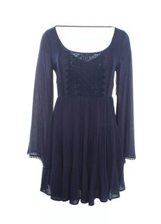 DejaVu Tiered Gauze Tunic with Crochet Trim & Open Back (Navy)  This is the perfect tunic to pair with your favorite bralette and pair back to your best fitting leggings or jeans.  The beautiful crochet details add a lot of value while subtly adding texture to this beautiful lightweight gauze fabric. 100% Rayon